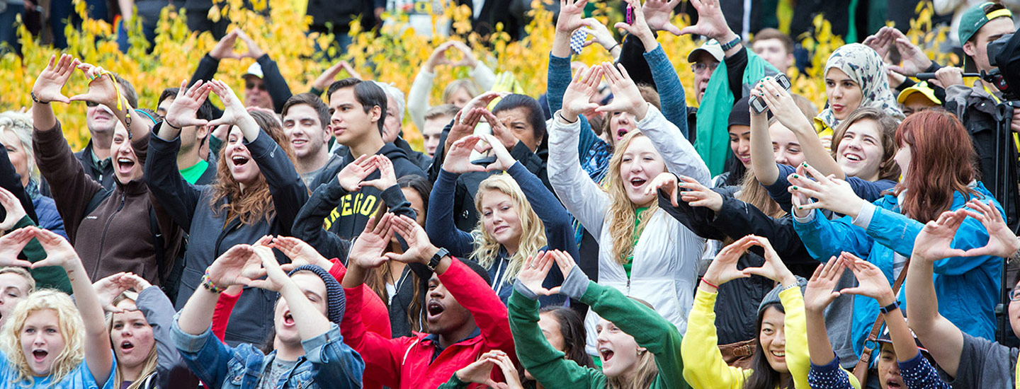 University of Oregon Homecoming crowd throwing the O.